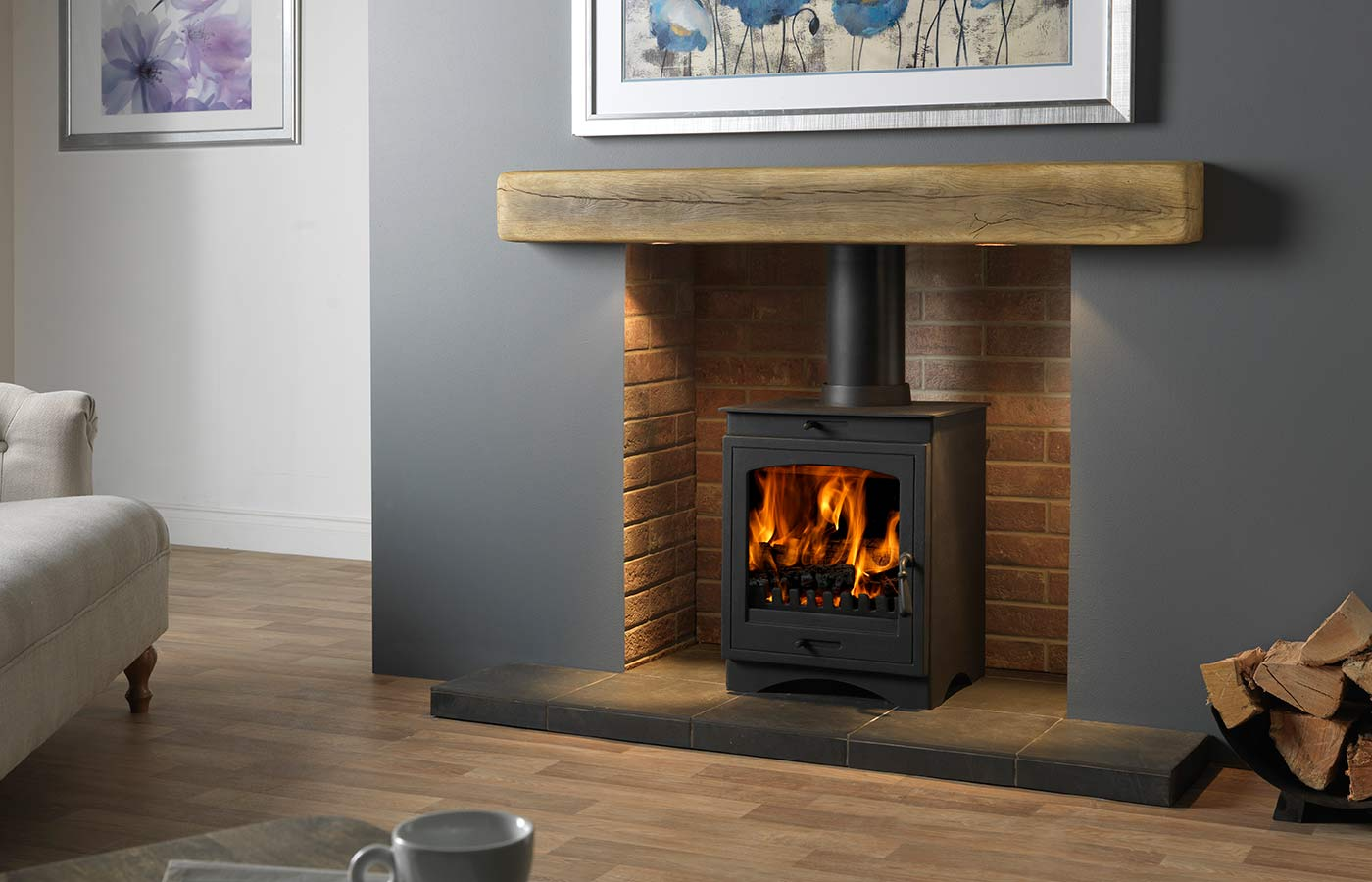 """Helios 8 Clean Burn Stove Shown with Red Ceramic Brick Bond Chamber, 54"""" Porcelain Slate Tiled Hearth and 54"""" Rustic Light Oak Effect Geocast Beam with Feature Lights"""
