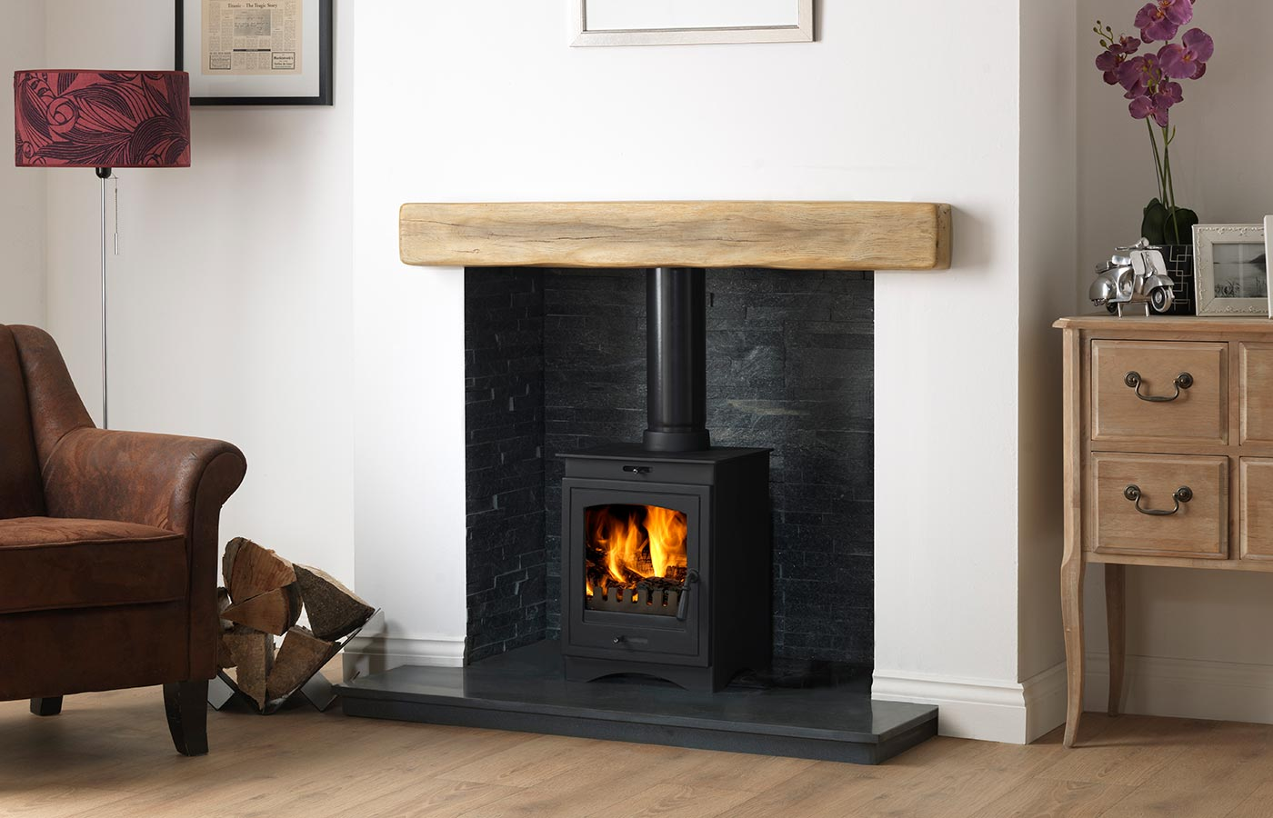"""Helios 5 Clean Burn Stove Shown with Staggered Black Slate Block Chamber, 48"""" Slabbed Honed Granite Hearth & Back Hearth and 48"""" Rustic Light Oak Effect Geocast Beam"""