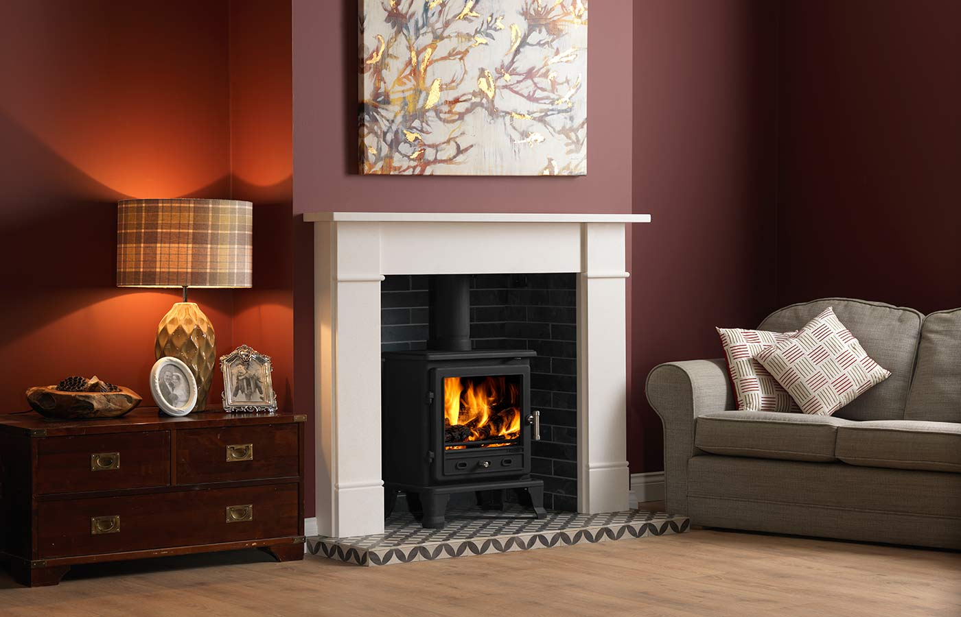 """Firefox 8 Eco Stove with 56"""" Brompton surround in Portuguese limestone, porcelain slate brick bond chamber, and 56"""" Star tile slabbed hearth."""